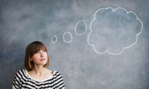 woman with thought bubble on chalk board