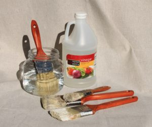 Use distilled vinigar to clean dried up paint brushes