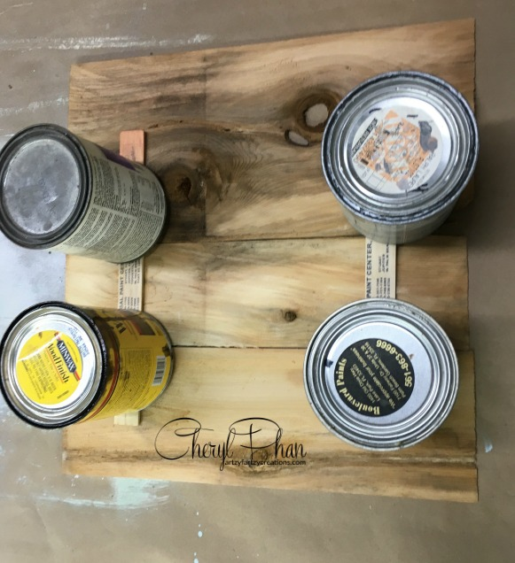 Paint cans on sticks