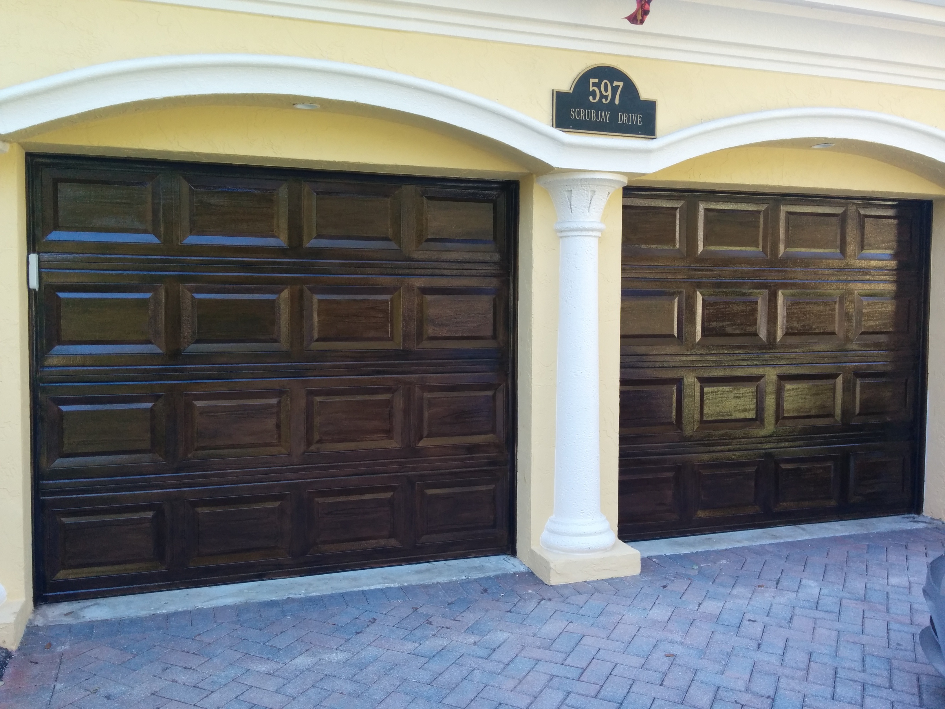 How to wood grain garage doors faux finish decorative for Wood look garage doors