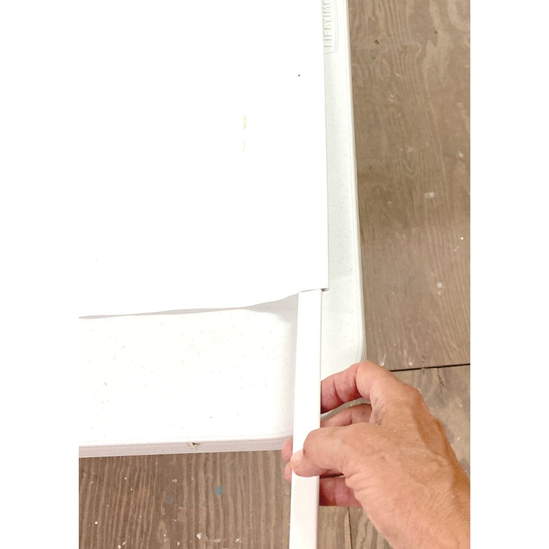 Create a decorative window shade with contact paper